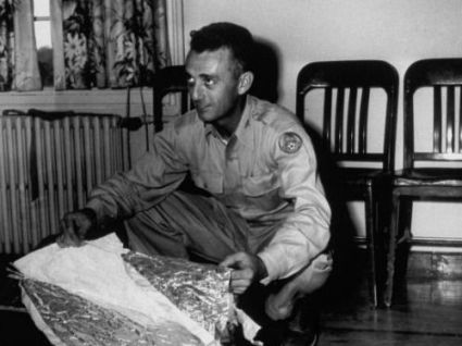 Major Jesse Marcel is believed to have helped clear the wreckage of an alleged alien ship that crashed landed in Roswell, New Mexico, in 1947. Here, Marcel displays the remnants of a weather balloon he claimed was found at a press conference following the incident.